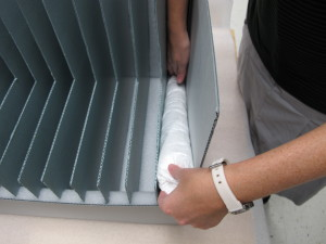 Fig. 3. Tyvek pillows are inserted into the bottom of each segment of the rack.