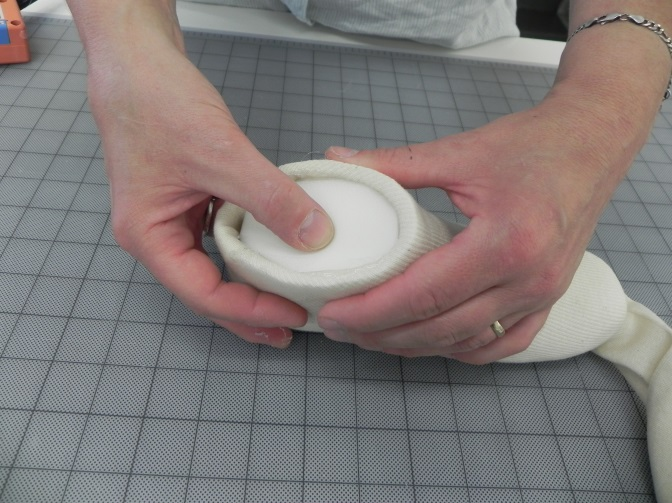 Fig. 4 Attach the oval cap with hot melt glue.