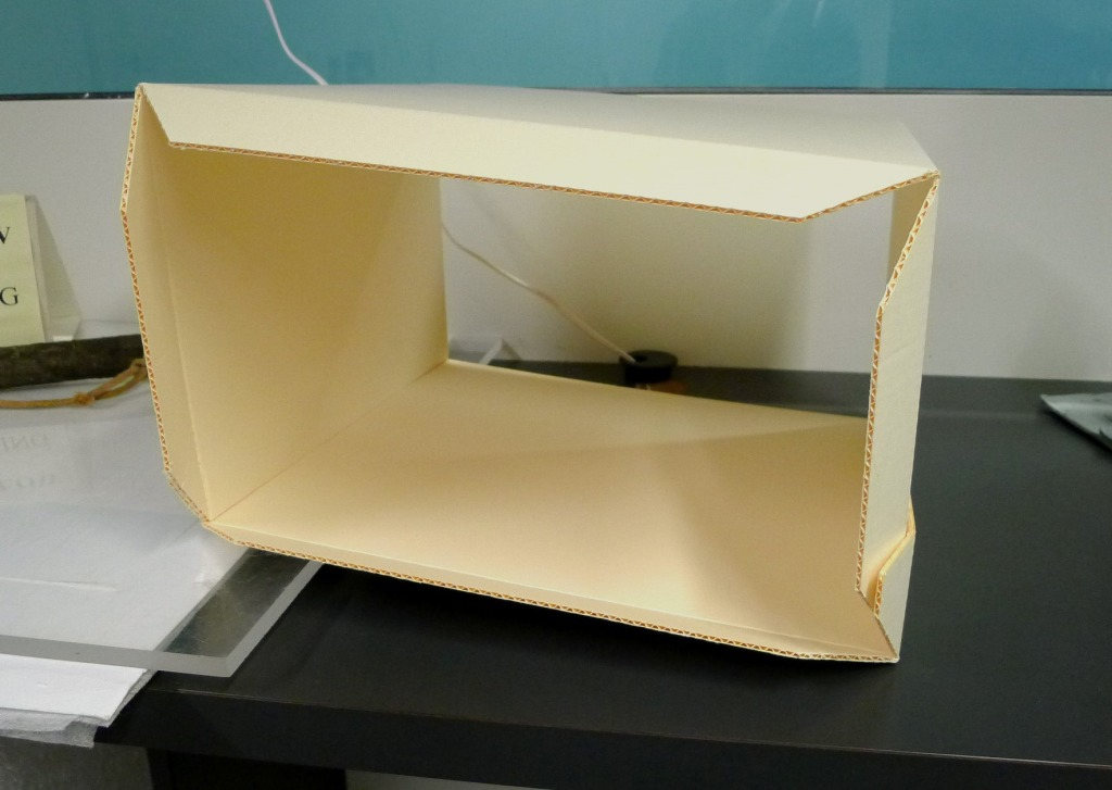 IMAGE 6: Construction of the box lid, with the edge flaps visible prior to trimming.