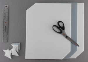 IMAGE 1: Placards consist of an inner board layer and outer foam layers, with two notched corners to facilitate handling