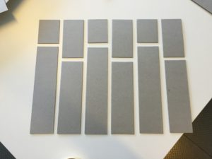 Figure 5: Middle layer of the base, cut into vertical strips to create the interlocking pieces.
