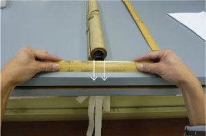 Fig. 10 - Measure the diameter of one scroll knob. In this case, the knob has a diameter of 2 inches.
