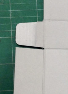 Fig. 7. Trimmed tabs ready to be glued to the exterior of the right and left sides.