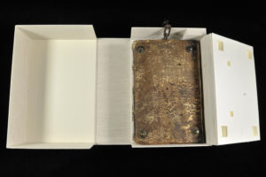 Housings are used to isolate objects that could damage other materials, such as this chained book, which could scratch adjacent materials.