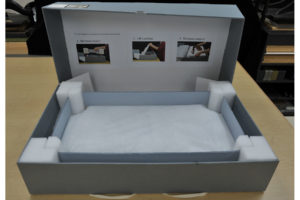 IMAGE 15: Support frame in place. Photo-enhanced labels in box lid illustrate proper opening procedure.