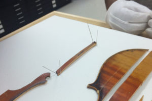 IMAGE 5: Sewing holes are marked with thin needles.