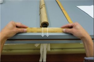 Figure 10. Measuring the width of the rolled scroll.